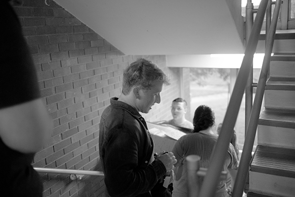 Elias Mertens in a dorm stairway on move-in day.
